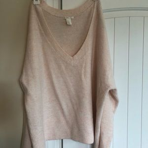 H&M light pink, loose-fitting sweater.